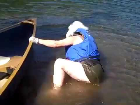 Senior woman falls stepping into canoe